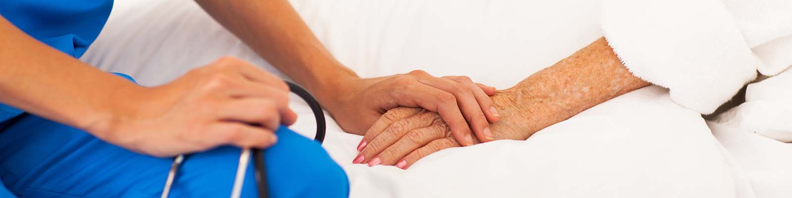 Provider holding a patient's hand