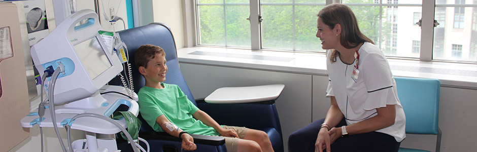 A Weill Cornell Medicine provider interacts with a patient.