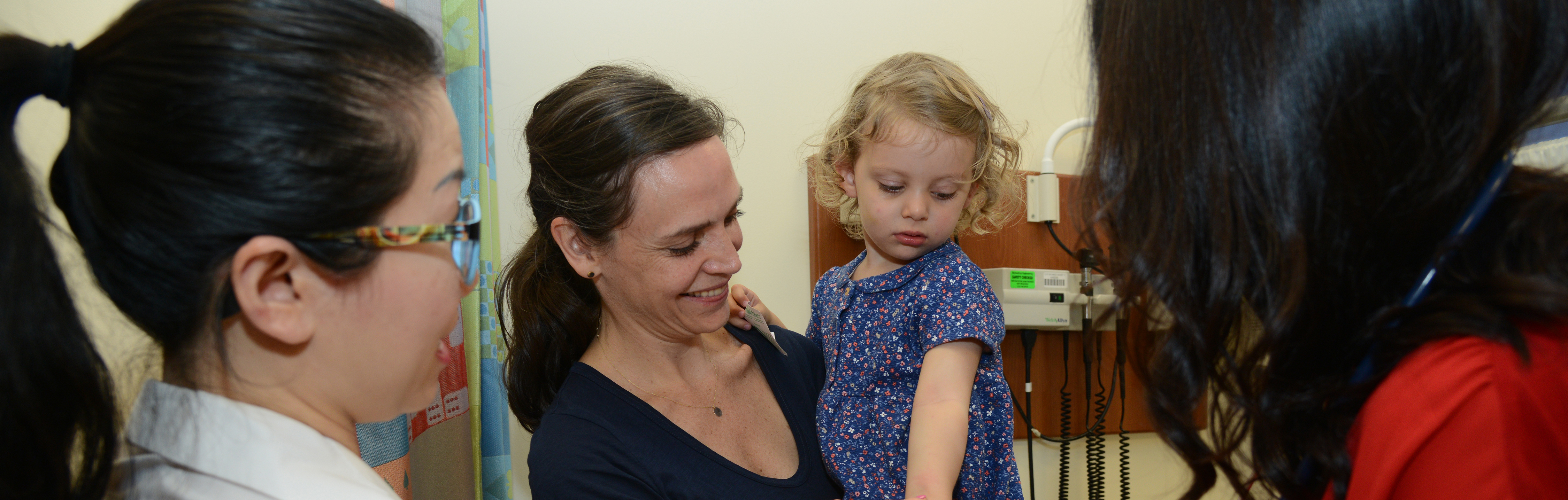 The Weill Cornell Medicine Pediatric Allergy and Immunology team examining a pediatric patient