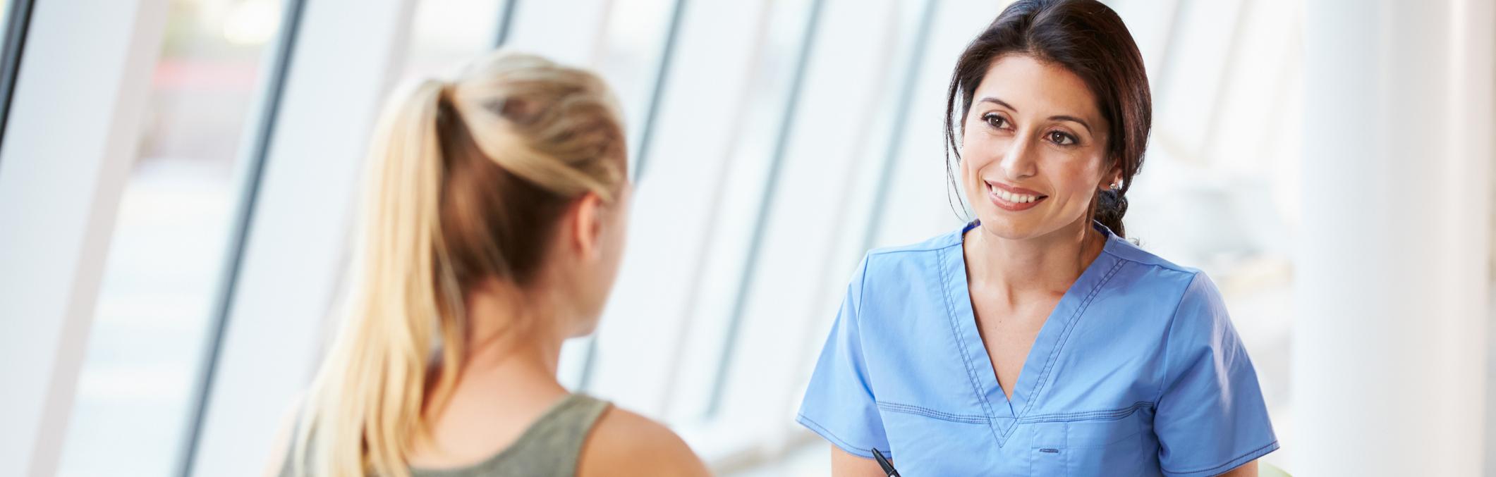 Nurse conversing with patient