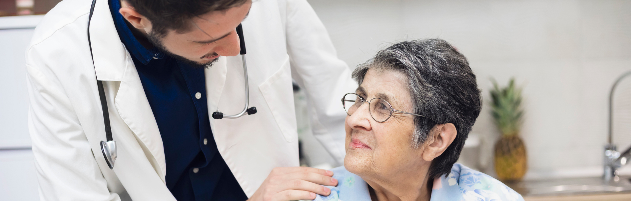 Doctor interacting with older patient.