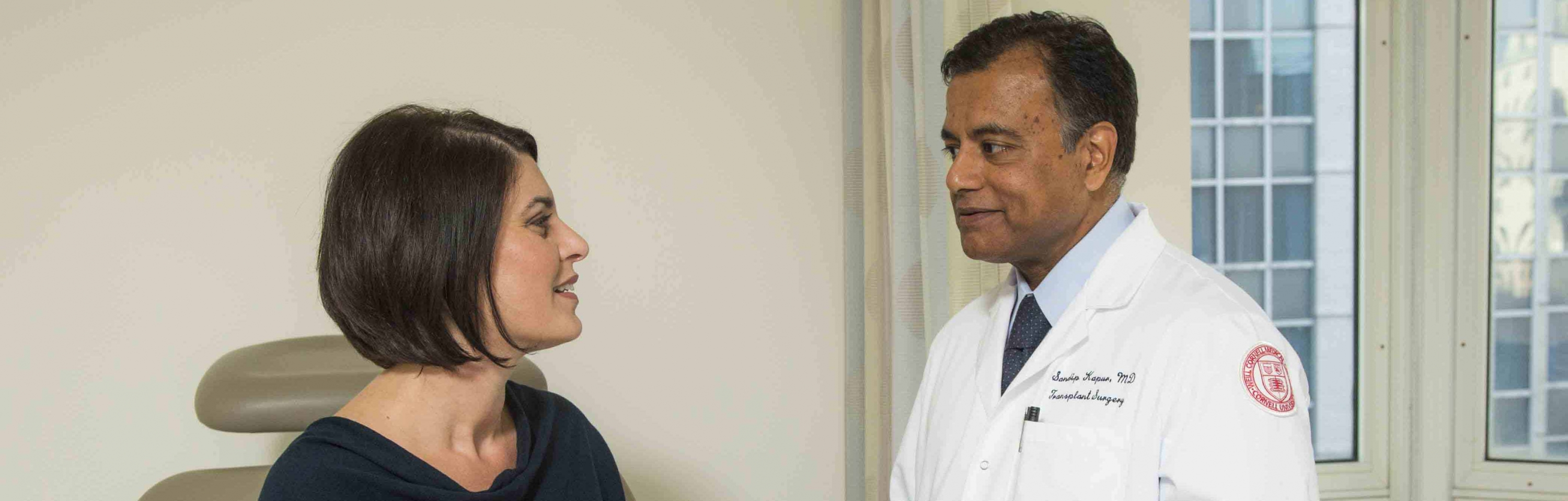 Dr. Sandip Kapur interacts with a patient.