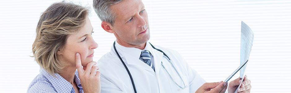 doctor and woman look at test results