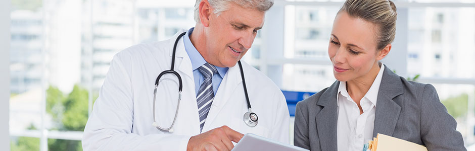 doctor and woman look at test results with happiness