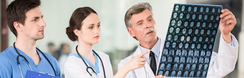 Doctors examining a brain scan