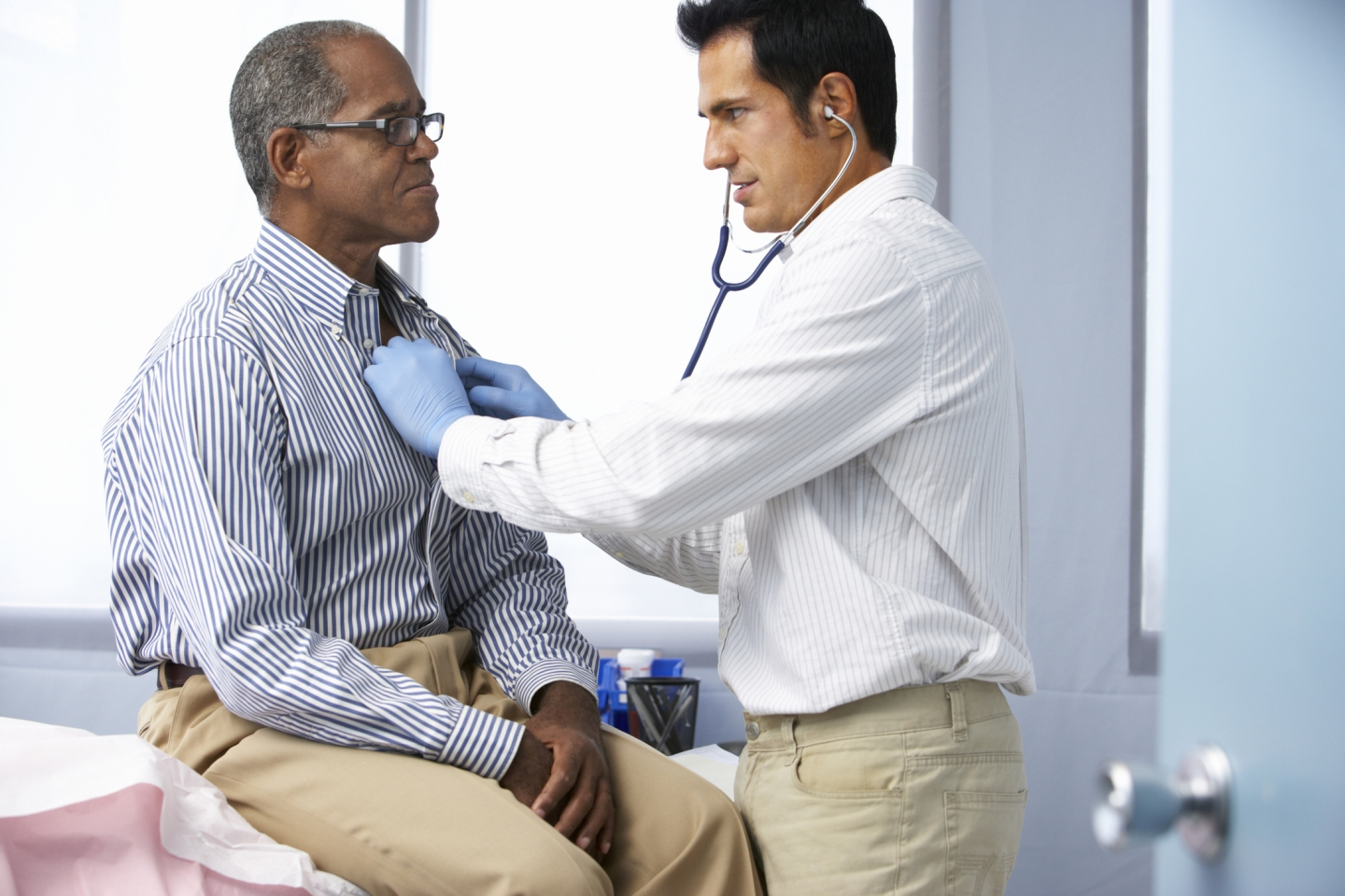 Doctor listens to a patient's chest using a stethoscope