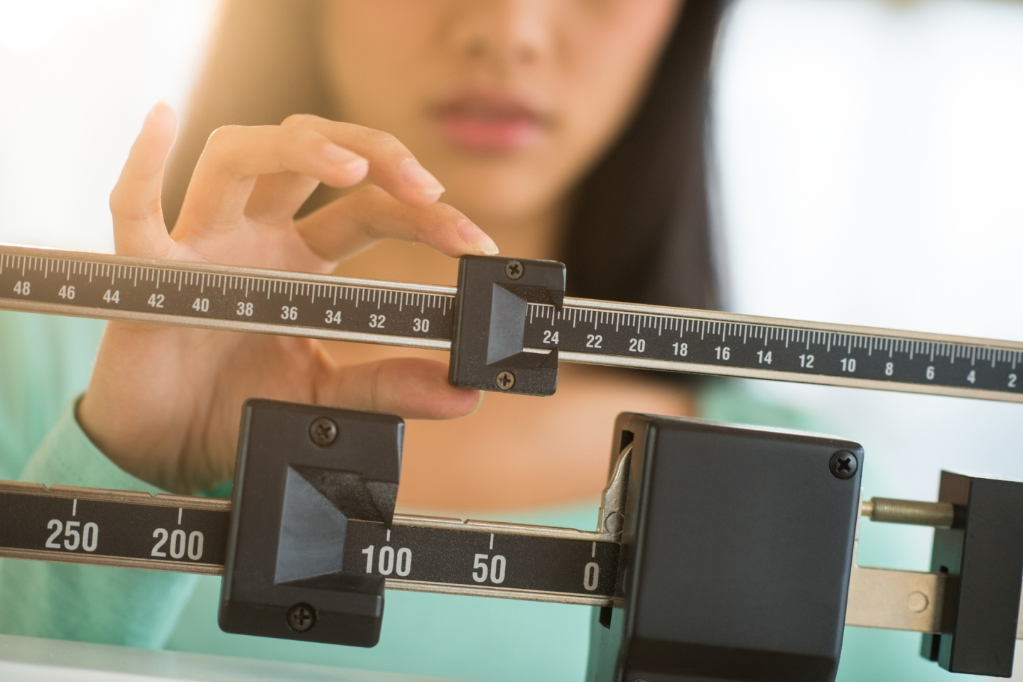 Close-up of a woman adjusting a scale