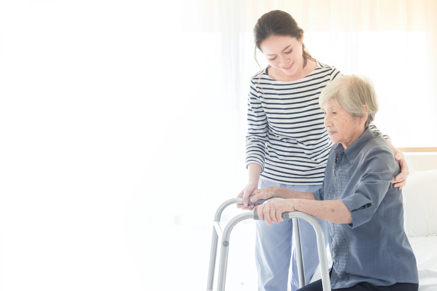 younger woman assisting older woman
