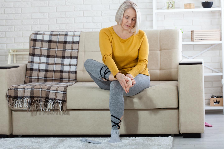 woman checks feet