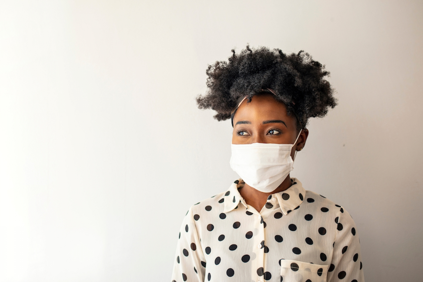 black women with her mask on