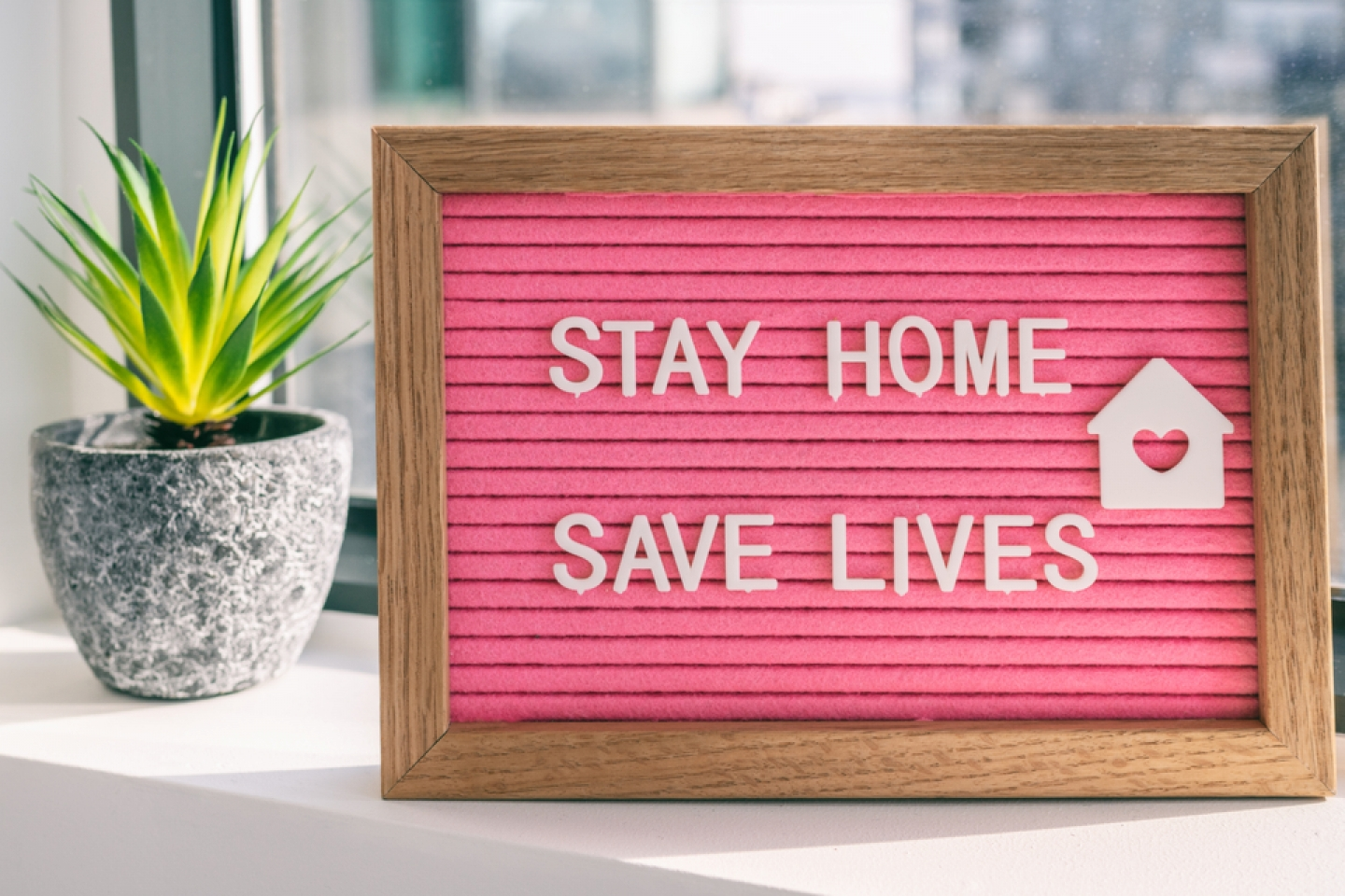 "COVID-19 Coronavirus ""STAY HOME SAVE LIVES"" viral social media message sign with text for social distancing awareness. COVID-19 staying at home concept. Flatten the curve."