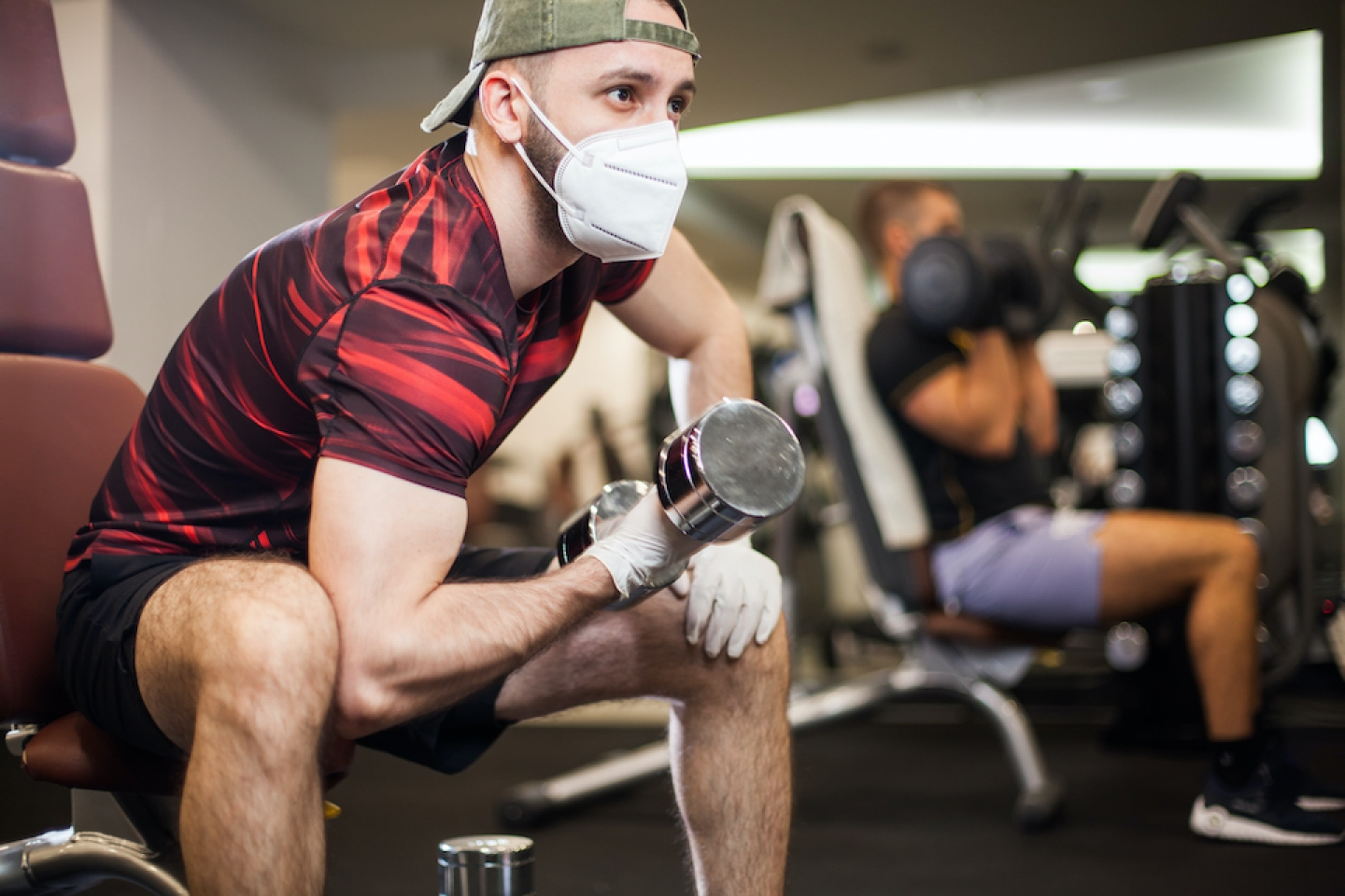 man working out at the gym with mask on