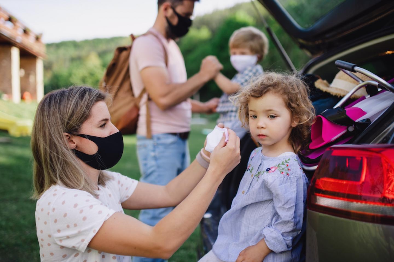 family wears masks