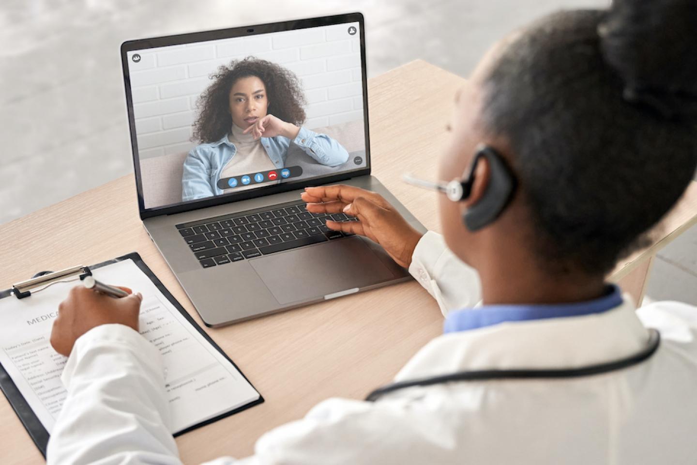 women speaking with doctor through telemedicine