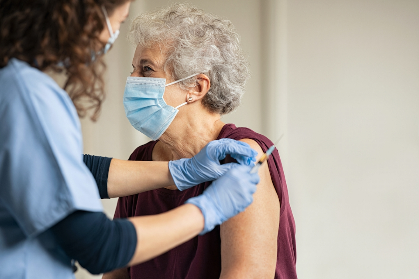 older female patient gets vaccinated