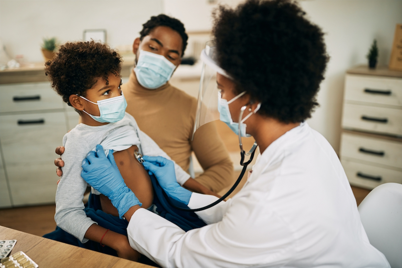 black doctor checks patients heart