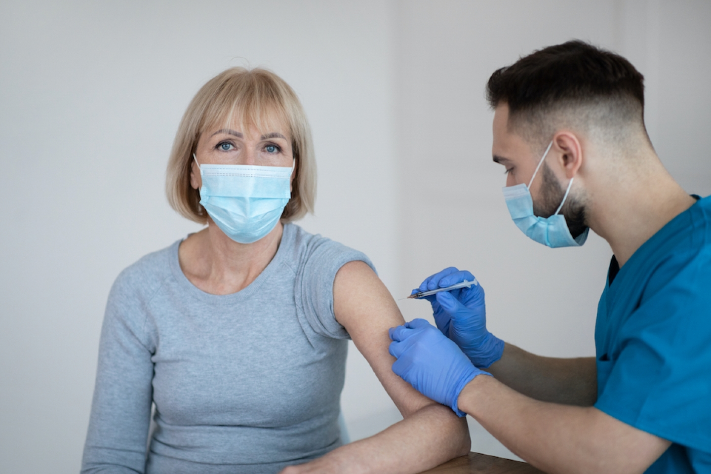 older female patient receives covid-19 vaccine