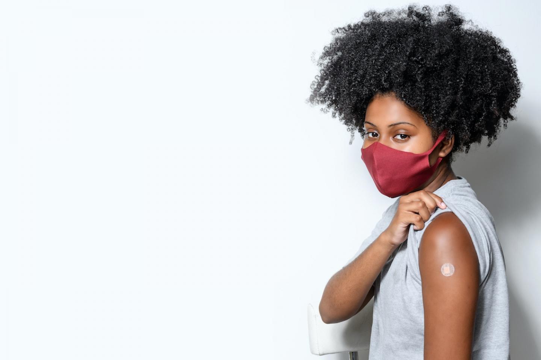 black woman receives vaccine shot