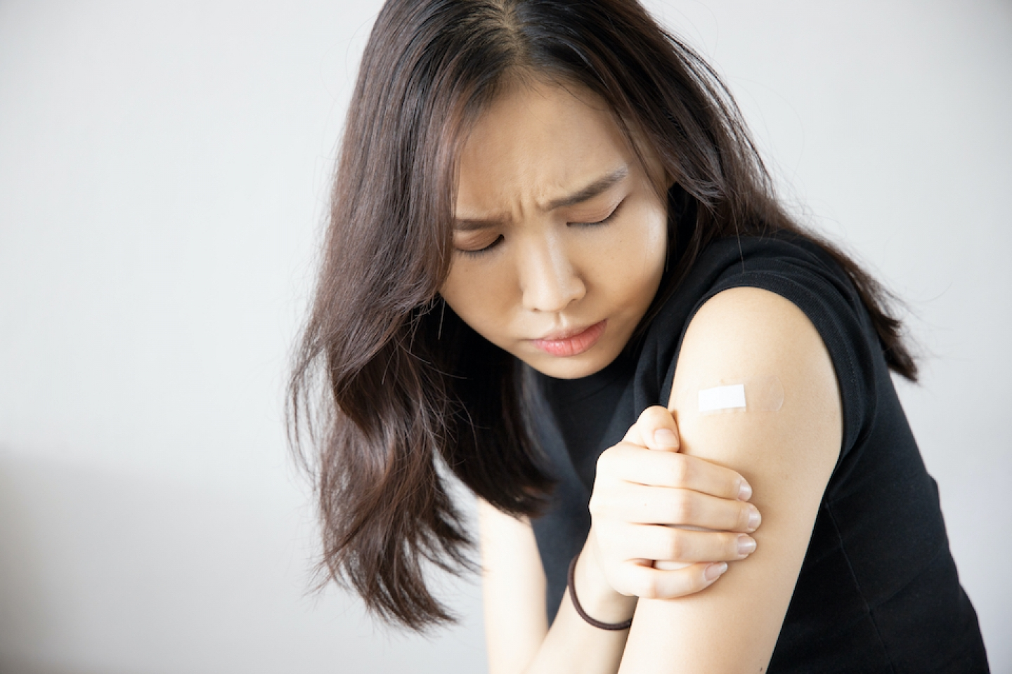 woman with sore arm near vaccine injection site