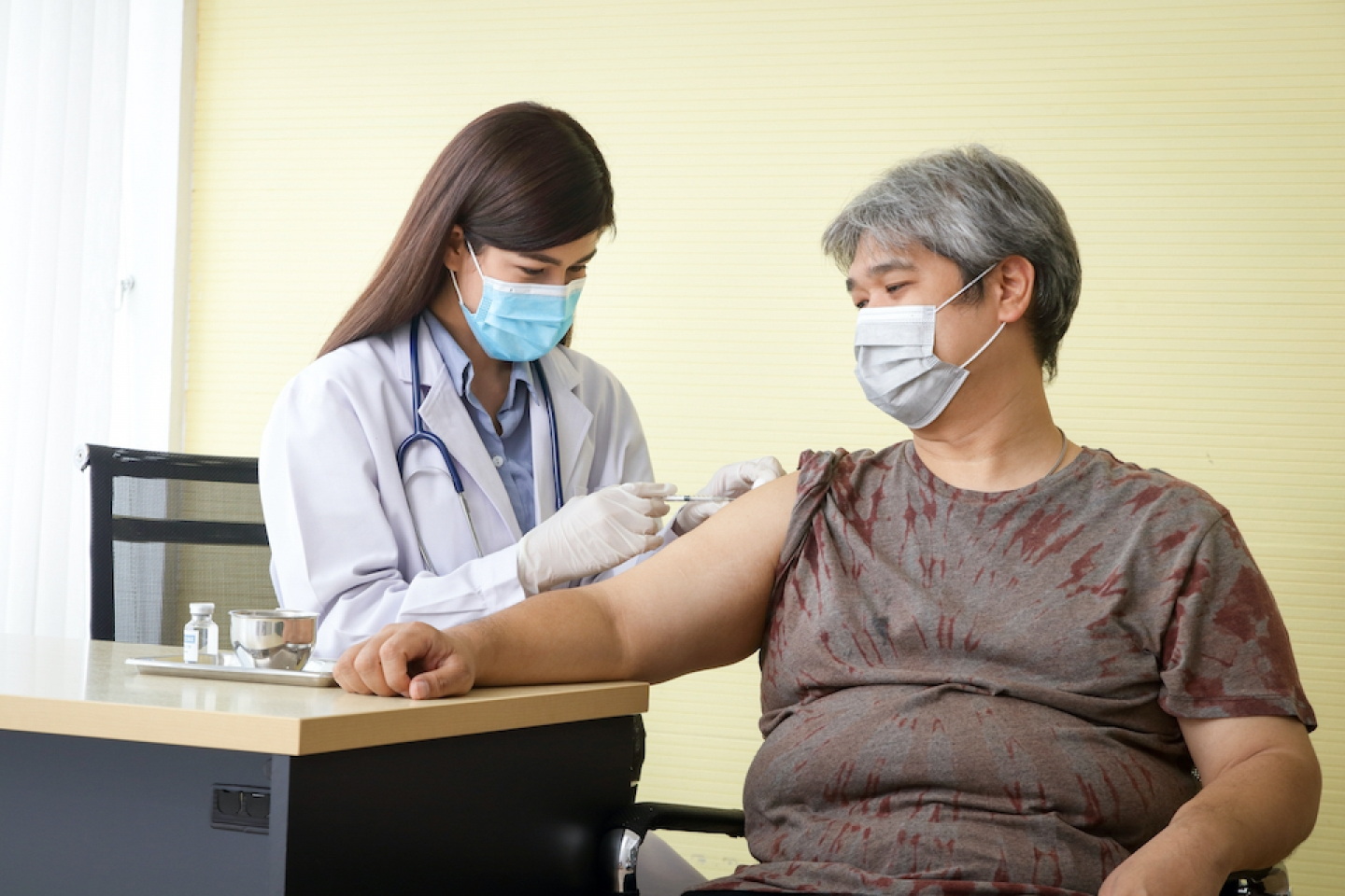 doctor administers vaccine to patient with obesity