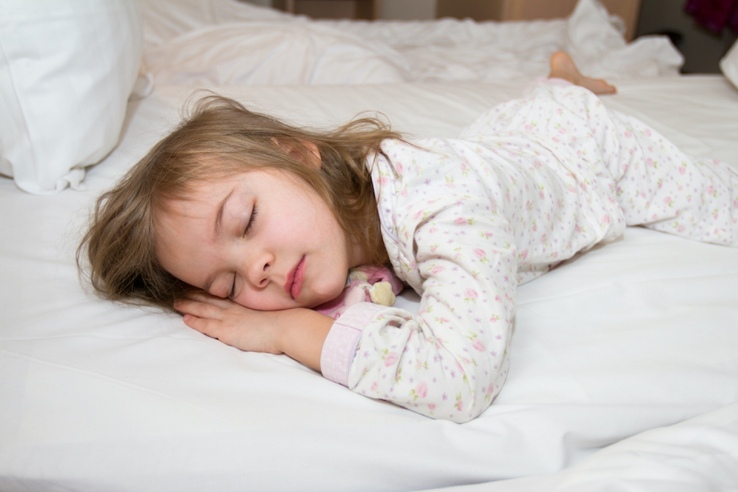 young child sleeping in bed