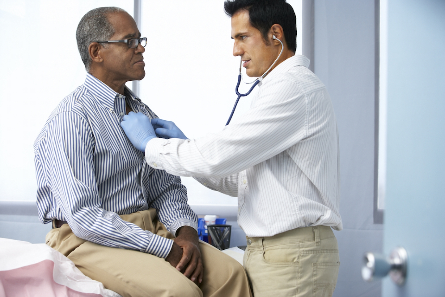 older black man meets with male doctor