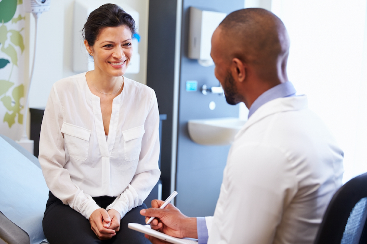 woman consults with doctor