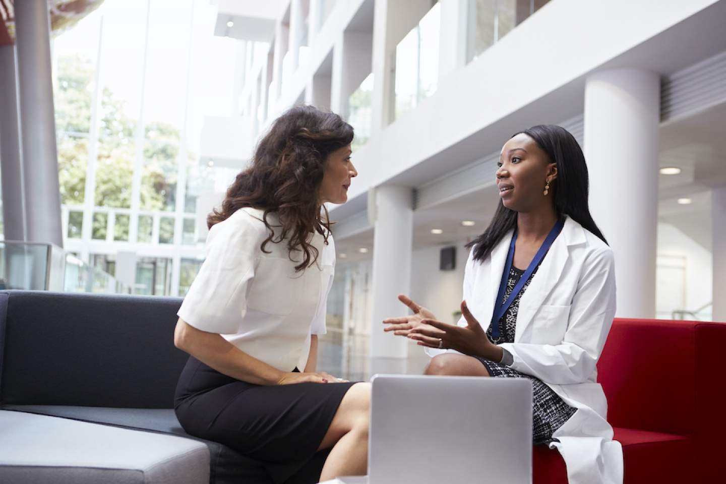 female doctor meets with female patient