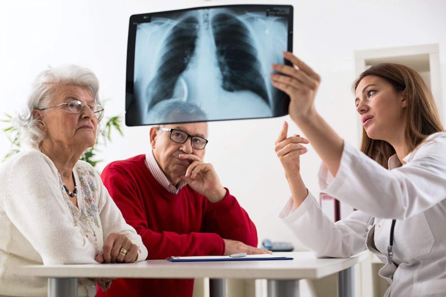 doctor and patients reviewing xrays