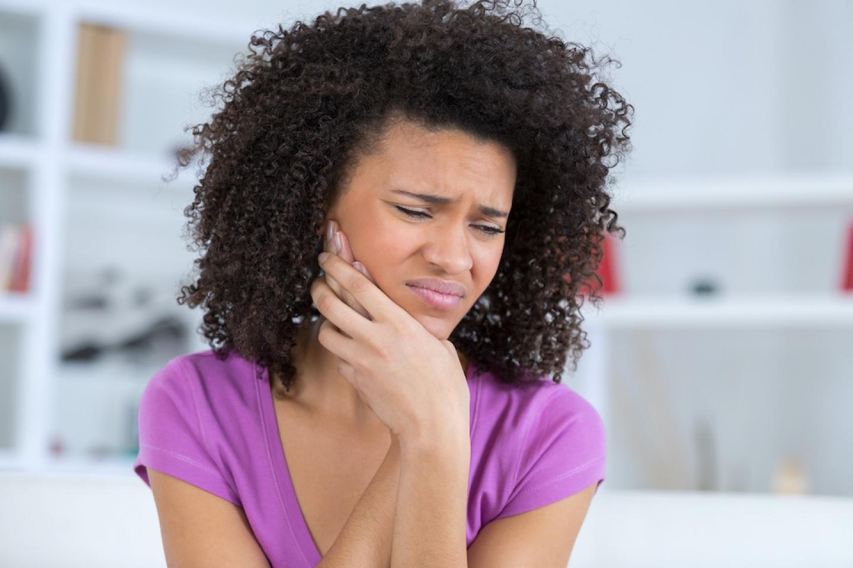 black woman has sore throat