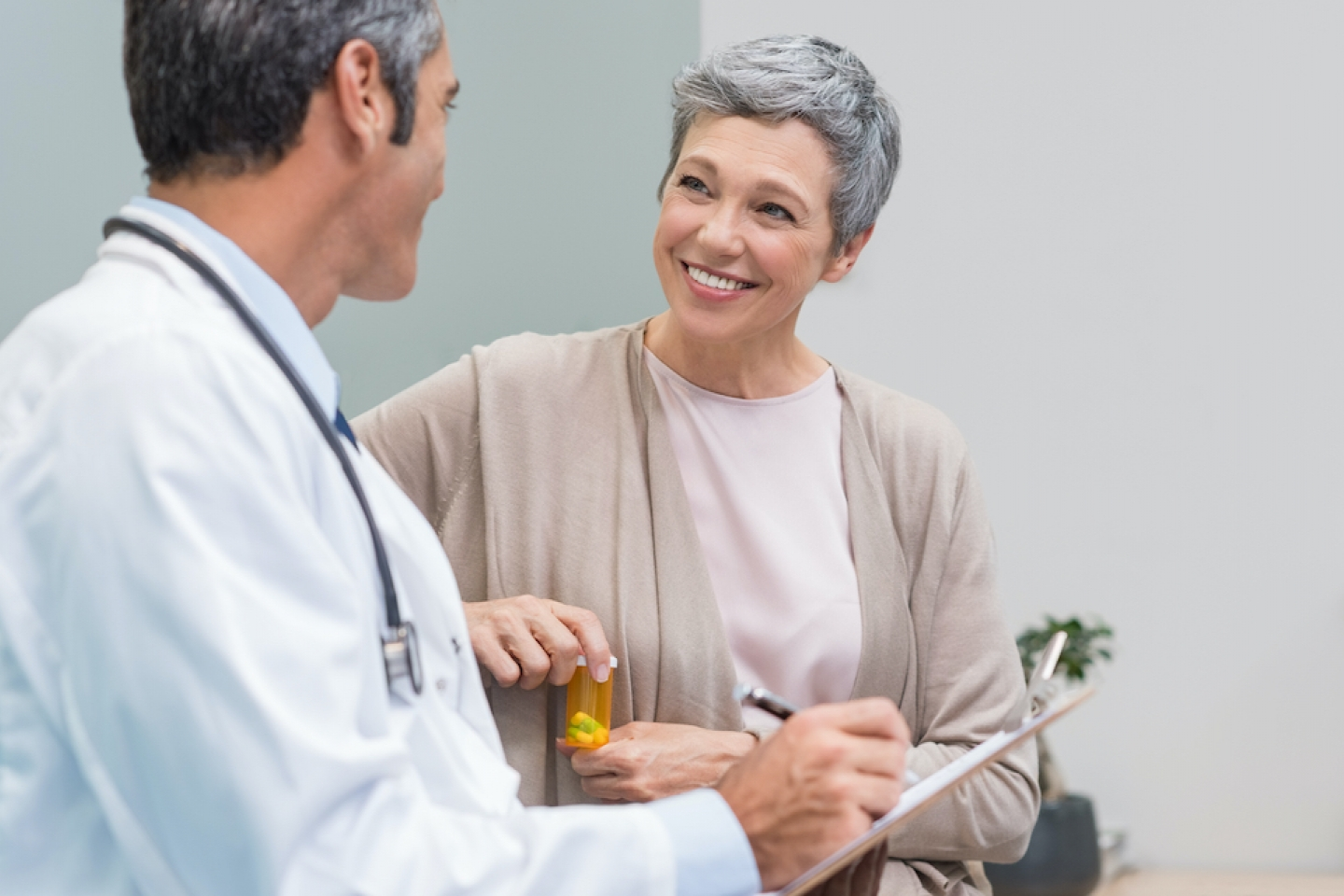 patient with medication speaking with their doctor