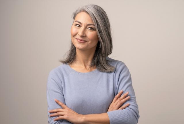 older woman folding arms cross