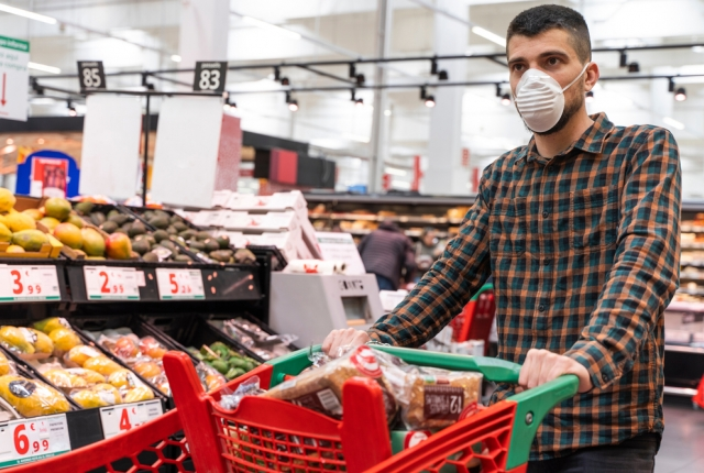 man wearing face mask while grocery shopping