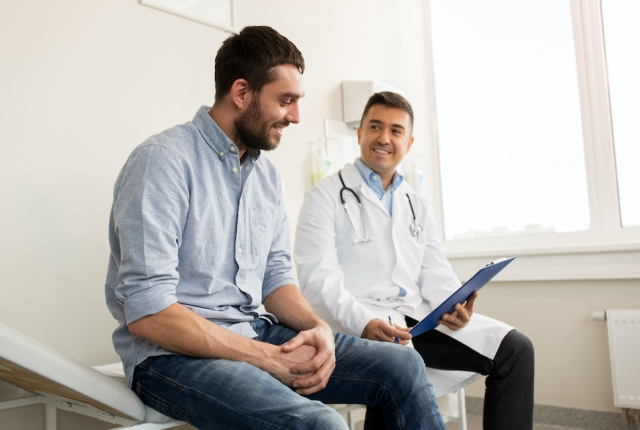 man smiling with doctor