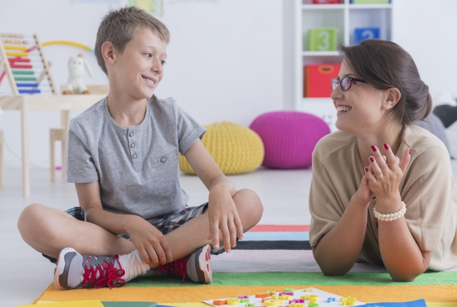 child with autism with school therapist