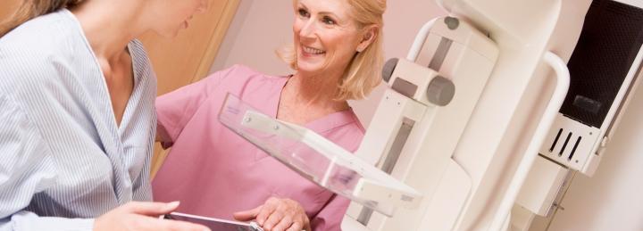 Woman preparing for a mammogram