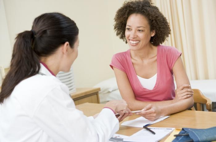 doctor speaks with women patient