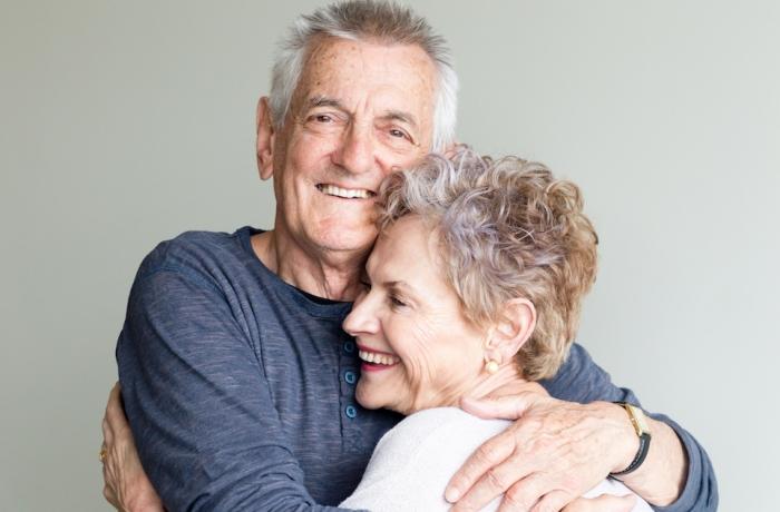 older couple hugging each other