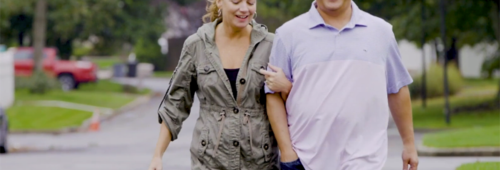 Sandy Krykostas walking with his wife.