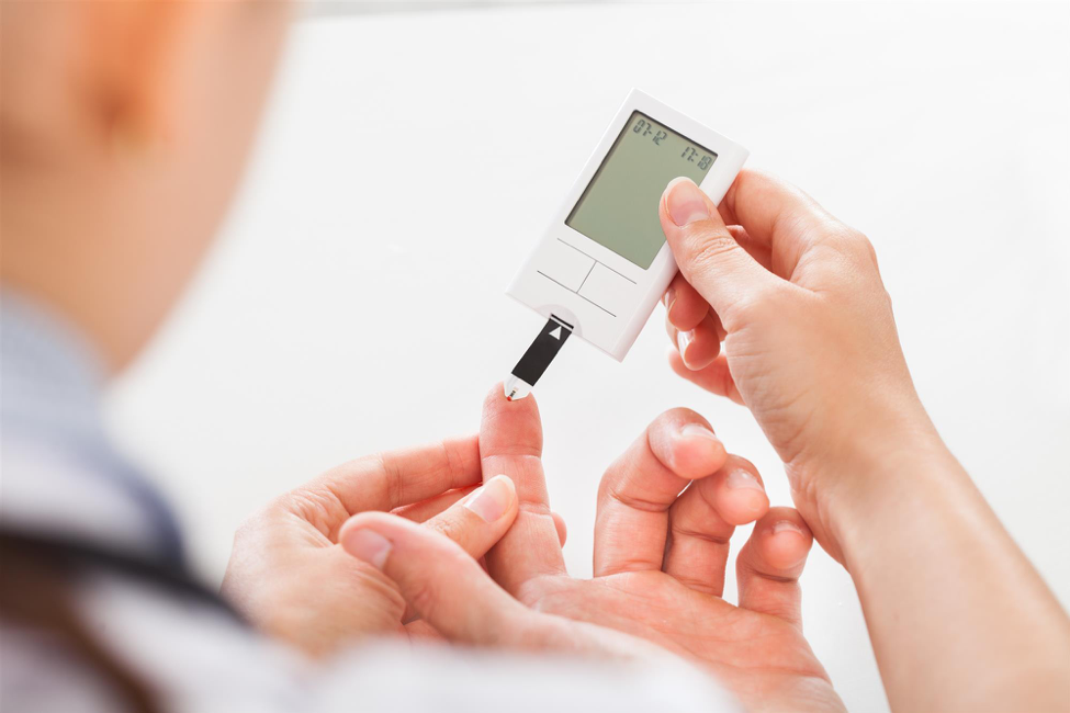 A patient tests their glucose level