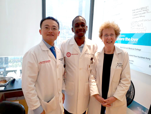 Dr. Joseph Bernard from Haiti poses with Weill Cornell Medicine physicians Drs. John Ng and Anne Moore.