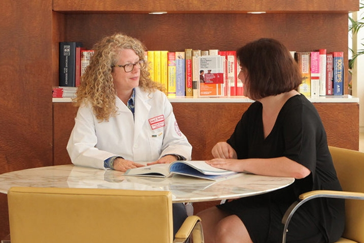 Myra Mahon Patient Resource Center staffer working with patient