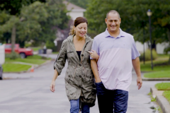 Sandy Krykostas walking with his wife.
