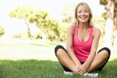 older woman exercising outside