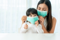 mom puts on mask her daughter