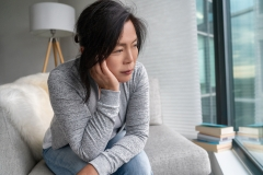 woman worried at home