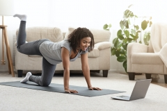 woman works out at home