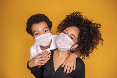 mom and son with mask on