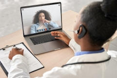 women speaking with doctor through telemedicine