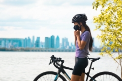 woman wearing mask while on bike